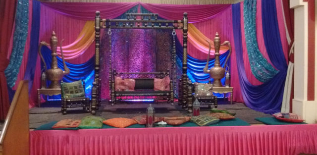 The main stage of the hall dressed for an Asian wedding